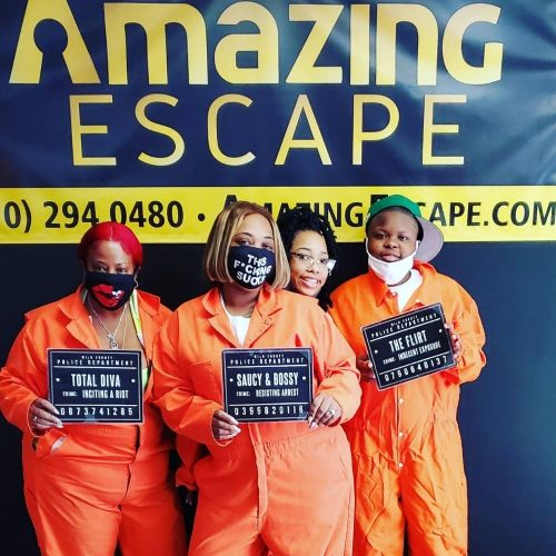 small group dressed as prisoners that escaped the room