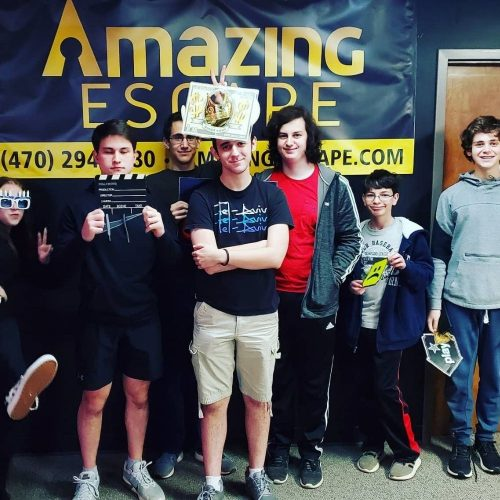 group of young people solving the escape game