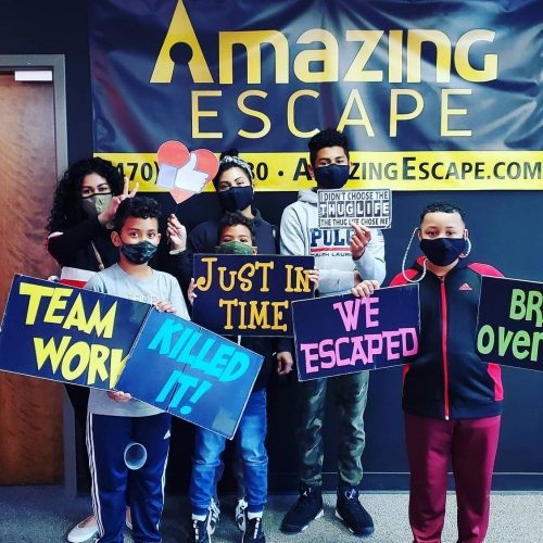 young group that managed to escape the room in 60 seconds at Amazing Escape