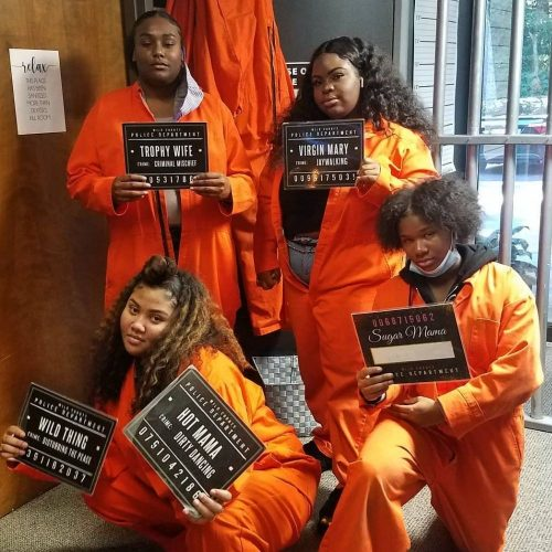 group of ladies in prisoners suites that just finished Prison Break team game